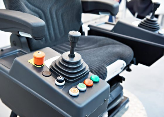 Joystick on driver seat for construction vehicle